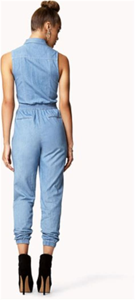 forever 21 denim jumpsuit forever 21 lightly faded denim jumpsuit in blue light
