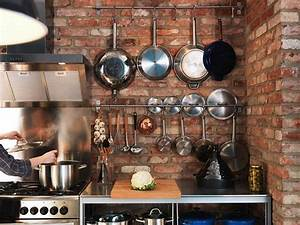 Pot and pan organizer buying guide homestylediarycom for Kitchen cabinets lowes with utensil wall art