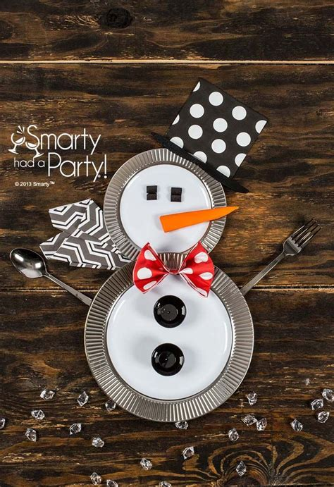 Snowman Table Decorations - table settings disposable plates and snowman on