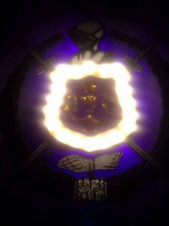 omega psi phi fraternity  shield  lots  light