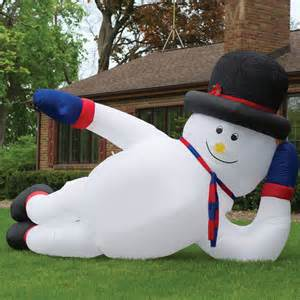 massive inflatable sprawling snowman the green head