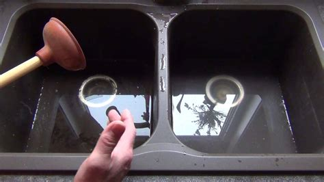 How to unplug your kitchen sink using a plunger! Plumbing
