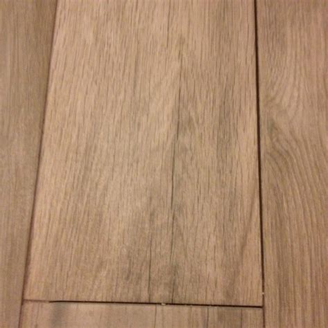 grout color decision for wood look tile floor