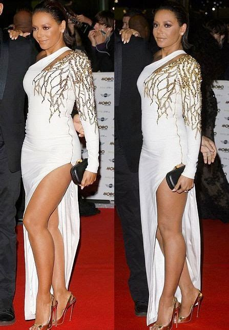 Melanie Brown flashes her gorgeous legs in a Long Gown on ...
