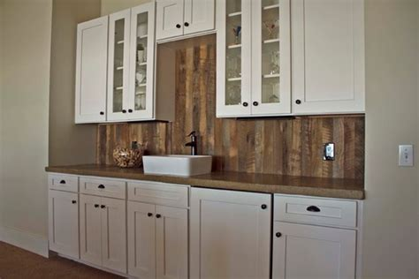 kitchens with white cabinets what material is used for the backsplash 8798