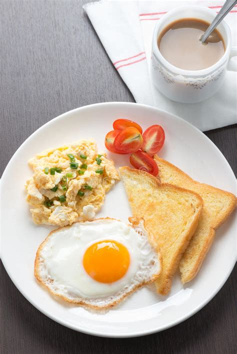 According to a fascinating new study published in the british journal of nutrition, if you have your morning dose of caffeine before you eat your breakfast, you could be negatively impacting your blood sugar levels and ultimately raising your risk of developing heart disease and diabetes down the road. Breakfast Coffee, Fresh Fried Egg And Scrambled Egg With Bread Stock Image - Image of freshness ...