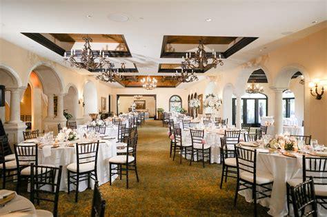 Romantic Indoor Ballroom Reception with Black Chiavari