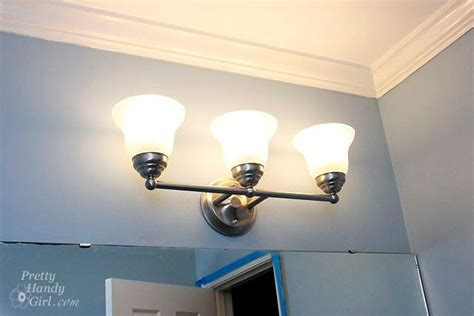 How To Change A Bathroom Light Fixture by Changing Out A Light Fixture Bye Bye