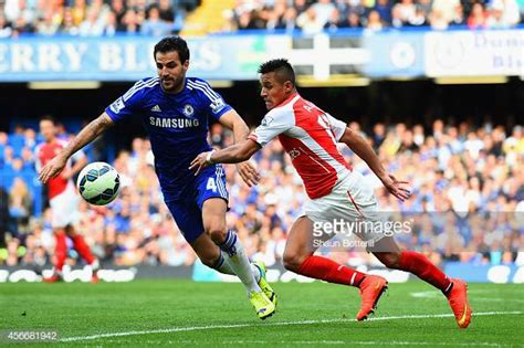 Cesc Fabregas of Chelsea and Alexis Sanchez of Arsenal ...