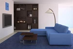 salon bleu 50 idees deco pour integrer le bleu dans son With tapis ethnique avec canape angle bleu marine