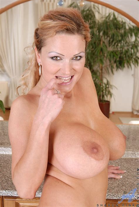 Seductive Hot Milf Sharon Pink Pops Out Her Massive Boobs While Slowly Taking Off Her Sexy