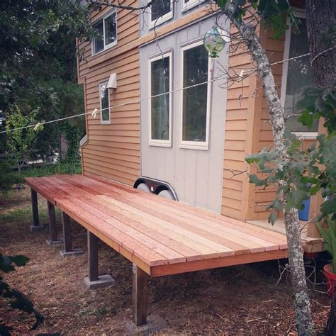 Tiny houses are better with folding redwood decks