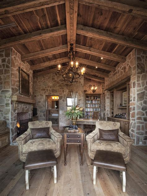 rustic home office  exposed beams stone walls hgtv