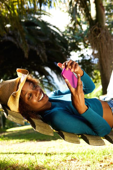 Mobile Hammock by On Hammock Holding A Mobile Phone Stock Image