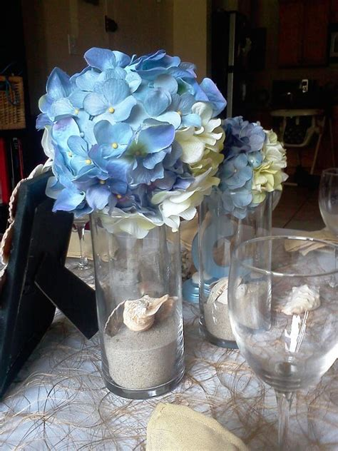 Beach wedding table decor blue/cream hydrangea pomanders