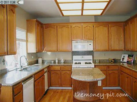 How to replace a fluorescent light fixture above a kitchen sink. Better but not exactly up to date.