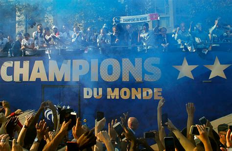 French Football Team Gets Hero's Welcome in Paris; See ...
