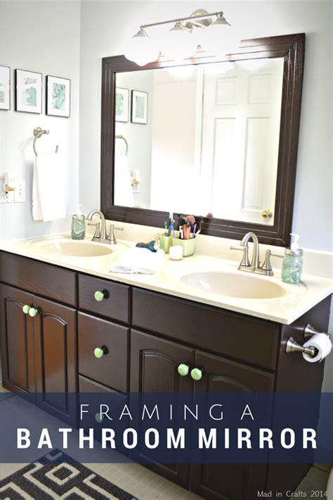 steps     framed bathroom mirror