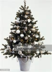 a christmas tree decorated with silver and white baubles stock photo getty images