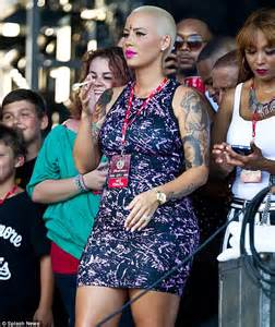 amber rose sports  inverted cross design   forehead