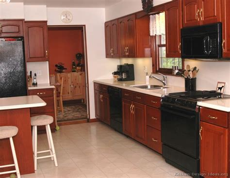 cherry color kitchen cabinets traditional medium wood cherry kitchen cabinets with black 5370