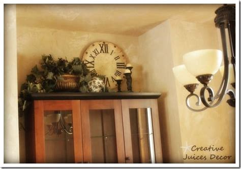 how to decorate the top of your kitchen cabinets creative juices decor decorating the top of your kitchen