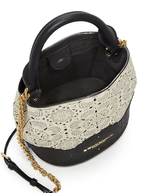 lyst burberry small  tone laser cut leather bucket