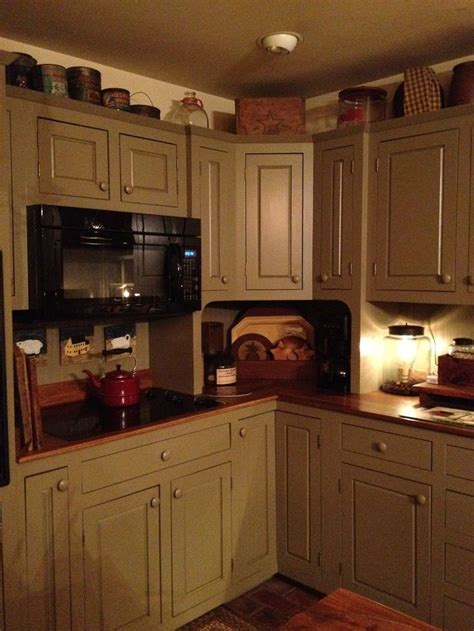 country painted kitchen cabinets the 25 best primitive kitchen cabinets ideas on 6194