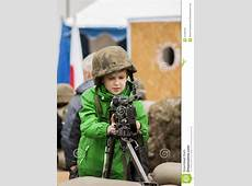 Young boy with machine gun editorial stock image Image of