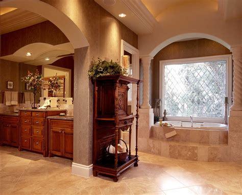 oval drop in tub Bathroom Mediterranean with arch doorways
