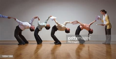 business people bending   stock photo getty
