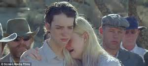 Elle Fanning and Nicholas Hoult share a romantic kiss ...