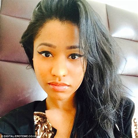 Nicki Minaj Shows Off Her Cleavage And Pert Derriere In