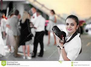 wedding photographer in action stock photo image 58972052 With what to wear as a wedding photographer