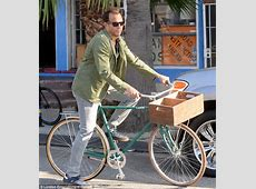 Will Arnett rides a bicycle on Venice Beach for Netflix