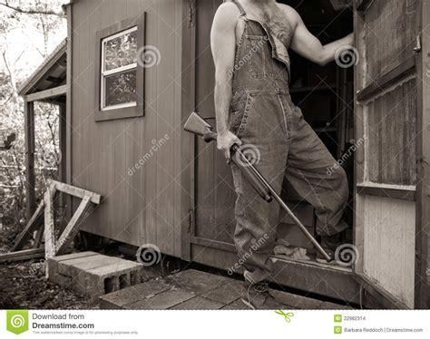 man  shotgun  overalls  hunting camp stock photo image  hunter rural