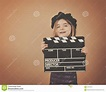 Vintage Child With Movie Film Clapboard Stock Photo ...