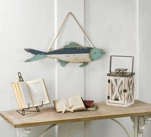 Cut enough off to go around what ever size cylinder or vase you may have. Decorative Wooden Wall Fish Decor - Tripar International, Inc.