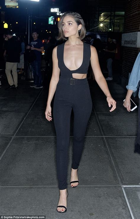 Olivia Culpo shows off cleavage in a plunging jumpsuit ...