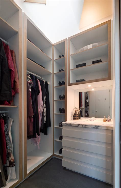 charming corner closet shelf with shoe collection next to