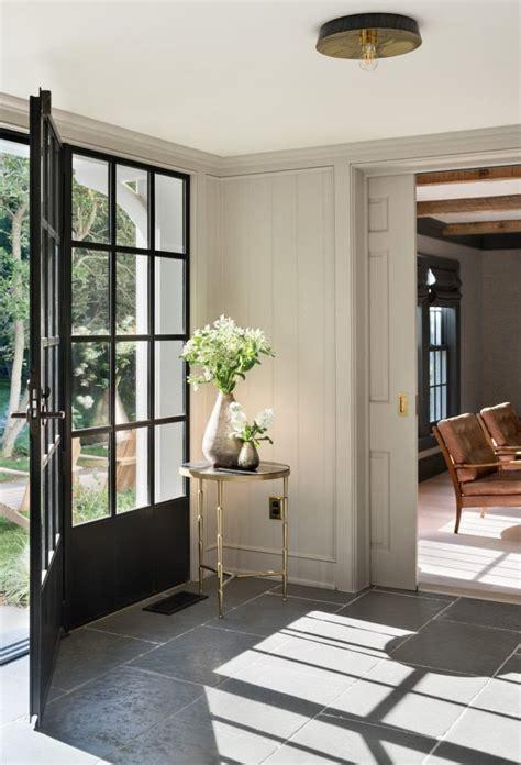 entryway steel windows door gray tile farmhouse renovation