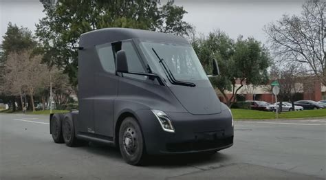 tesla truck tesla semi watch the electric truck burn rubber by car