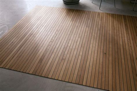 whoa, wood 'flooring' that rolls up like a rug. how cool