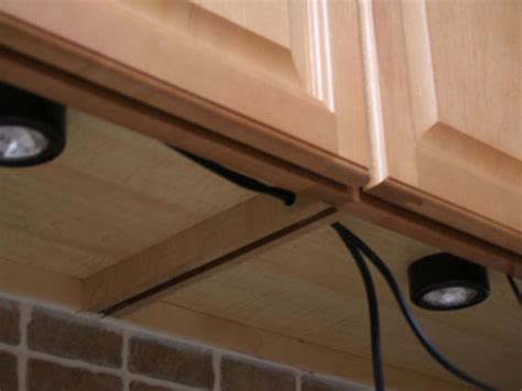 how to hide under cabinet lighting wires installing under cabinet lighting hgtv