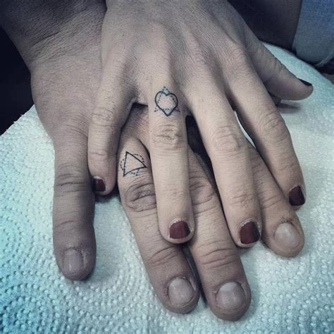 matching couple finger tattoos couples tattoo
