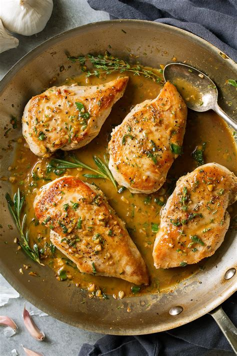 cooking chicken on a skillet skillet chicken with garlic herb butter sauce cooking classy