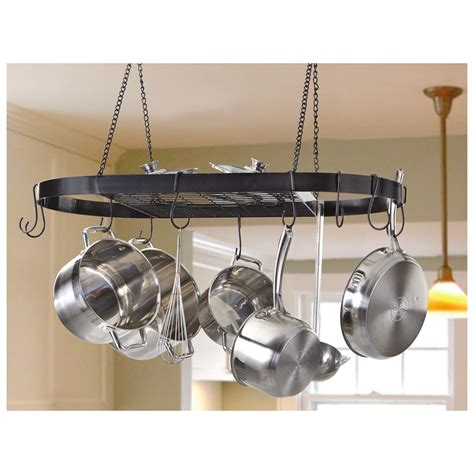 castlecreek wrought iron pot rack hangs from your ceiling for space saving pot and pan storage