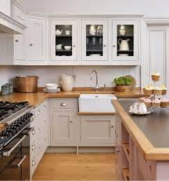 shaker style kitchen island shaker style cabinets in a warm gray with darker gray interior butcher block counter top
