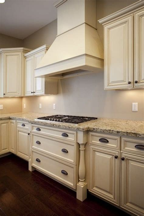 Love The Antiqued Cream Cabinets And Light Countertop