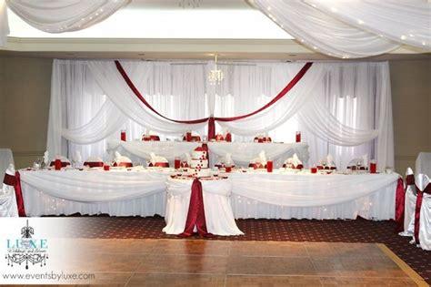 burgundy  white wedding backdrop  head tables